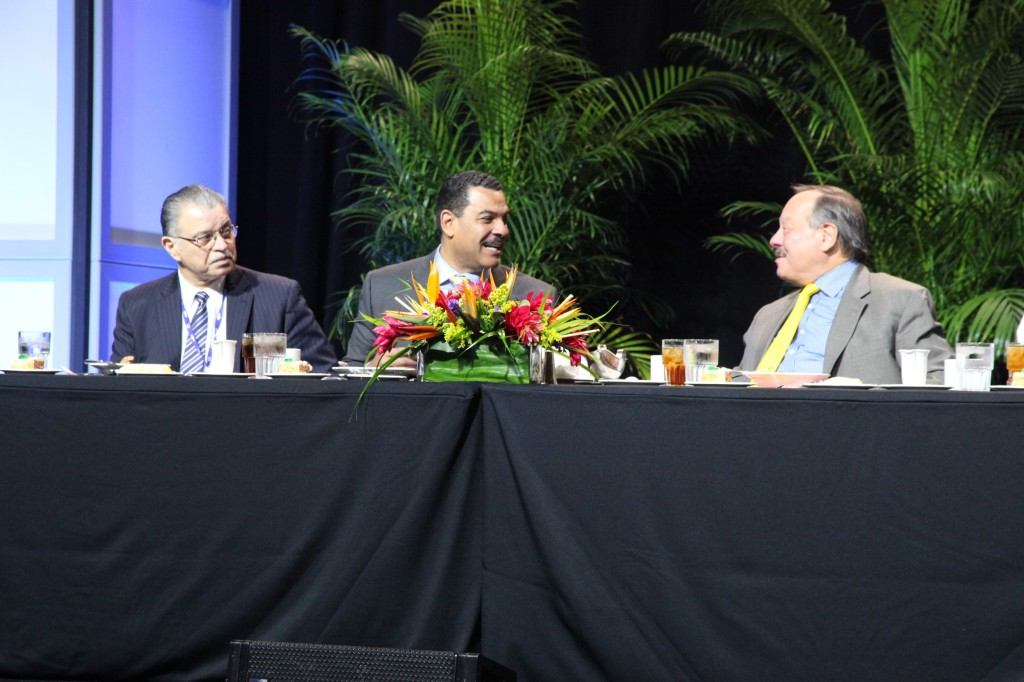 2014 NMSDC Luncheon speaker The Honorable Nelson A. Diaz of Dilworth Paxson (far right) shares a laugh before delivering his speech.